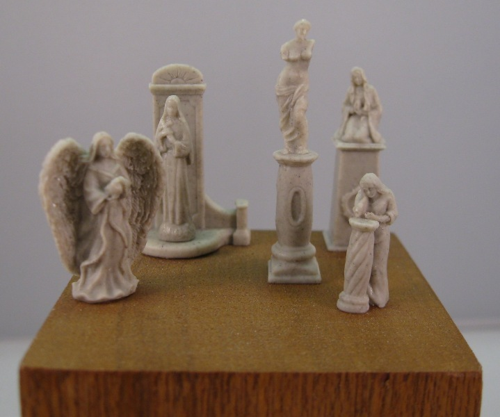 Small Statues and Pedestals Set